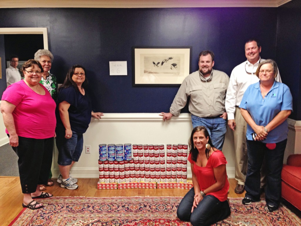 teambuilding wells insurance of wilmington donates to food bank of central eastern North carolina