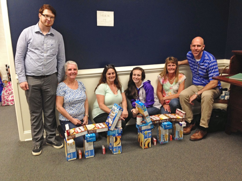 wells insurance of wilmington donates to food bank of central eastern North carolina
